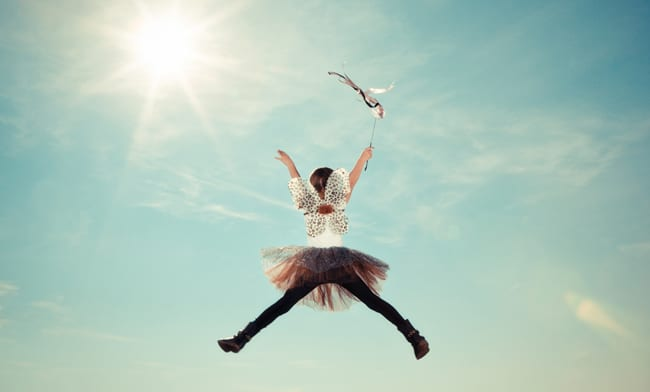 Girl in Costume Jumping to Sky at Kids Camp
