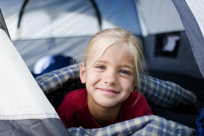 Young Girl Enjoys Her View From Kids Camp Tent.