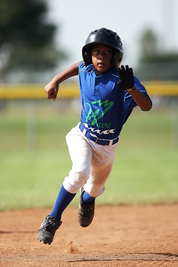 Young Camper playing baseball at sports camp