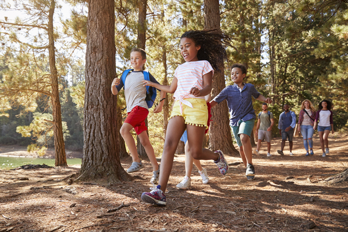 Children Running Ahead On Family Hiking Adventure